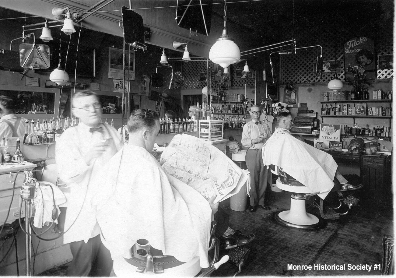 0001 – Henry Dennis in his barbershop c1925