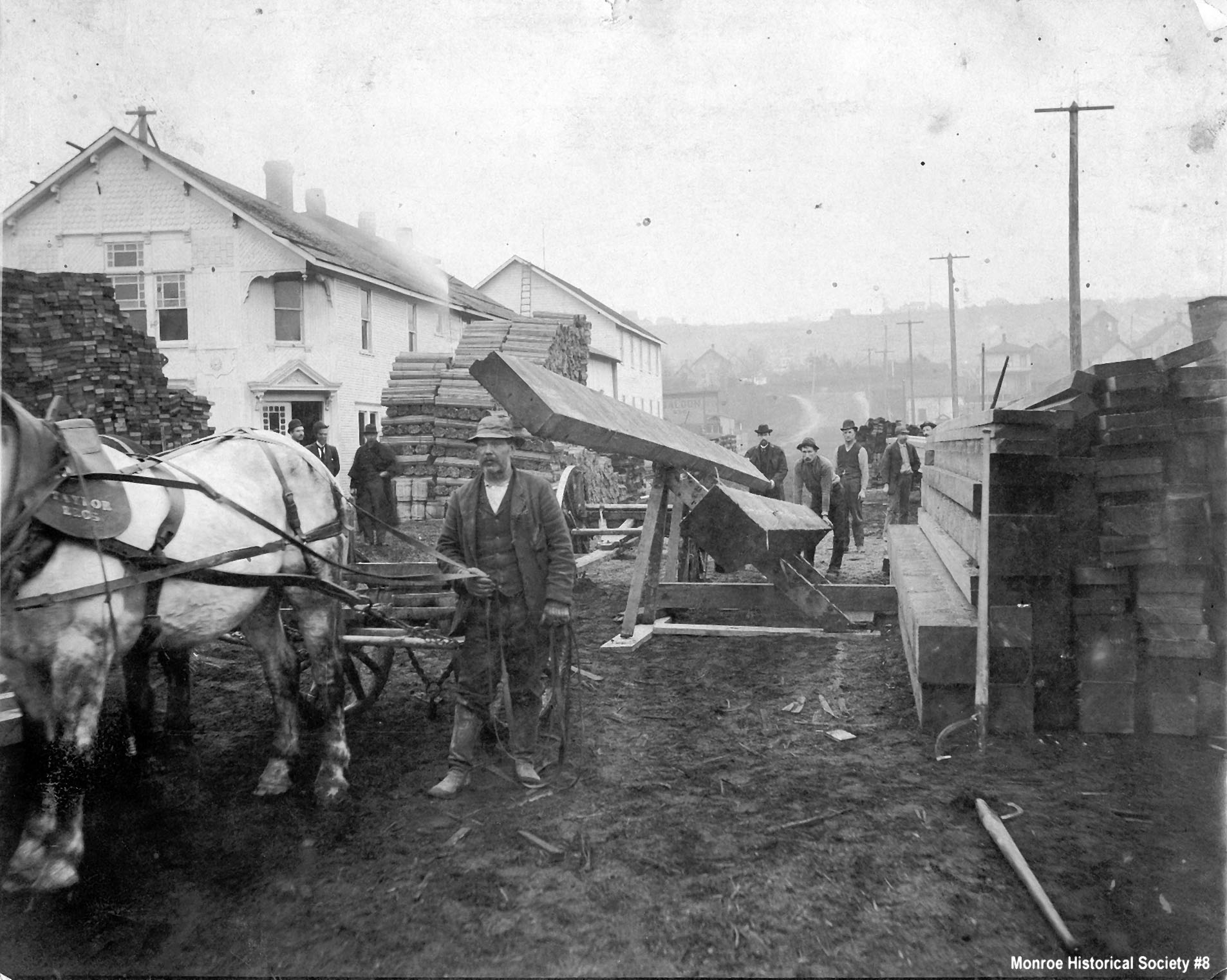 0008 – Joseph Dennis, the first horse teamster in Monroe, with his dray team