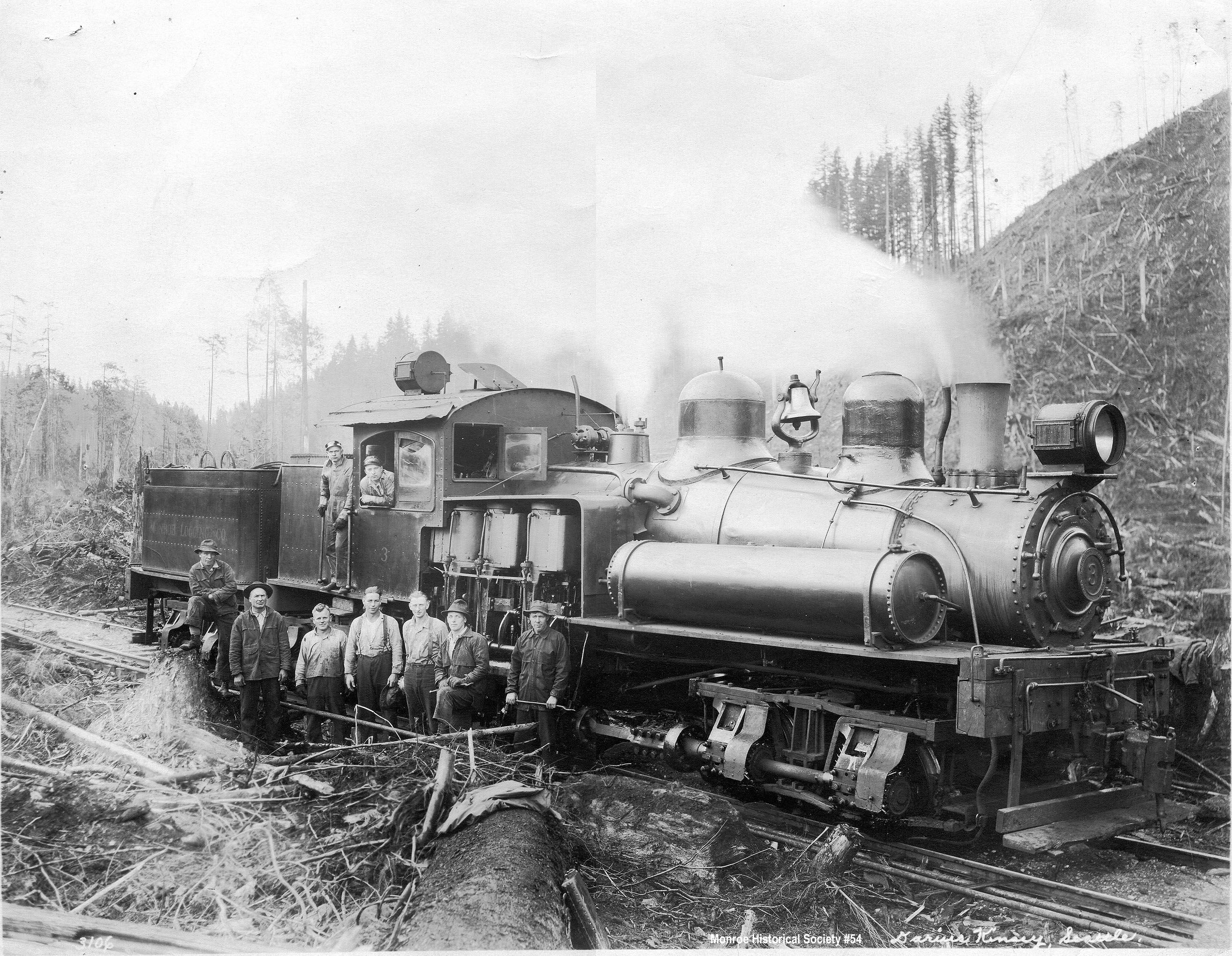 0054 – Shay locomotive with Ed Johnson in the cab, Monroe Logging Company c1924